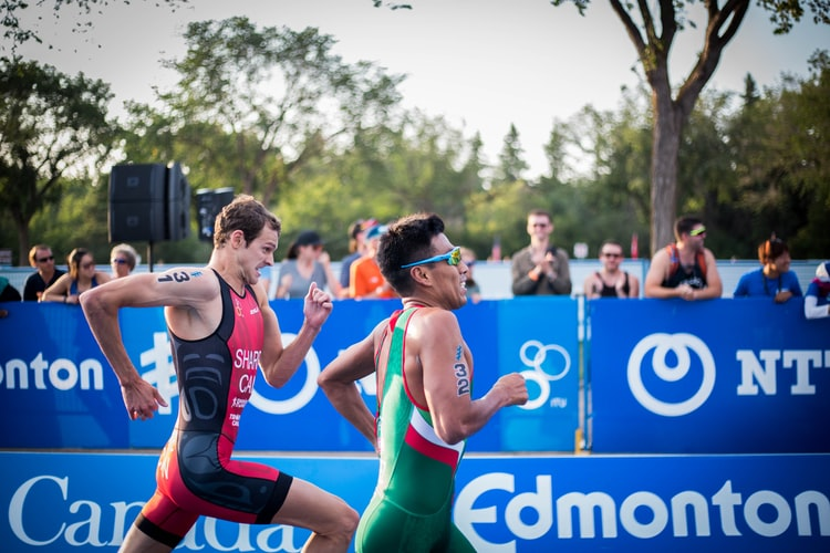 market opportunity analysis - two triathletes racing to the finish